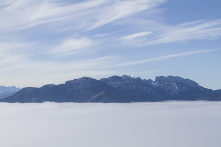 prospecting: View to southwest through the fog-covered Isar valley to Brauneck and Benediktenwand Stock Photo