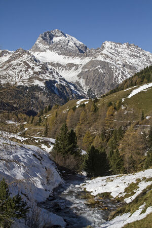watershed: Autumn time - Rhaetian Alps near the driveway to the Albula Pass Stock Photo