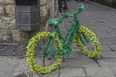 decorated bike: Ladies bike decorated with flowers and leaves Stock Photo