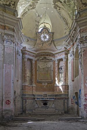 Exit, dirty and empty - old baroque church which to decay and vandalism