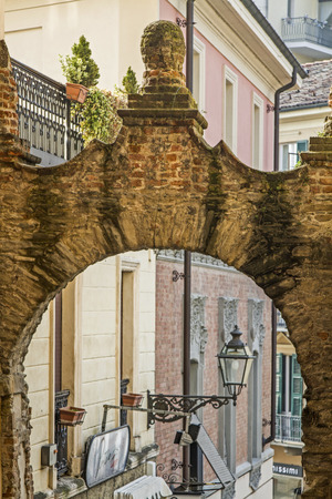 archway: Detail view of a lane with archway in Acqui Terme Stock Photo