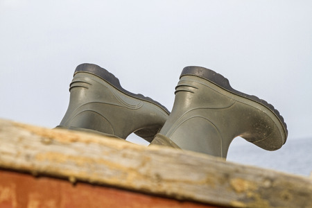 impermeable: Port Detail Rubber boots aboard a small fishing boat
