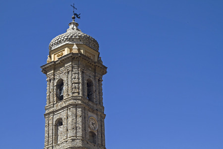 historically: Bell tower of the parish church in the Ligurian village of Badalucco Stock Photo