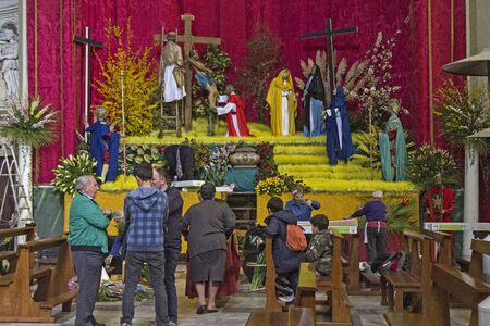 establishment: Easter preparations establishment of a religious scene in Ligurian village church