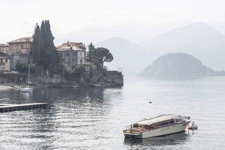 lake como: Varenna on Lake Como in the backlight