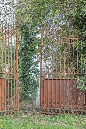 Open lattice door leads in abandoned land Stock Photo - 42864459