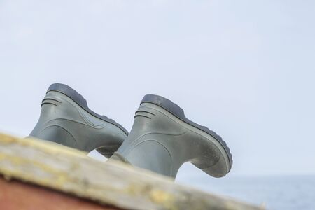 impervious: Port detail - rubber boots aboard a small fishing boat
