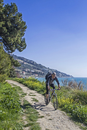 pista: When traveling on the Pista ciclabile Parco costiero between San Lorenzo and San Remo Stock Photo