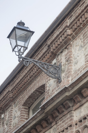 source of iron: Traditional street lighting in Cuneo