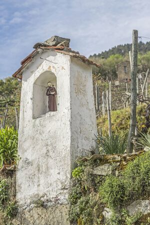 backcountry: Small shrine surrounded by vineyards in the Ligurian backcountry Stock Photo
