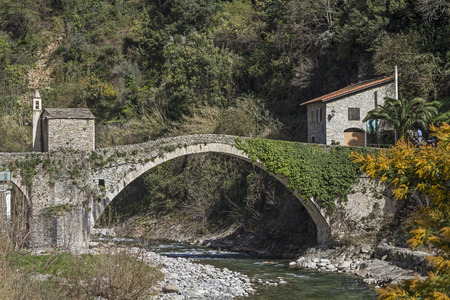 Badalucco - the arch bridge with chapel is the symbol of the small Ligurian village