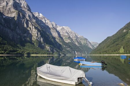The Lake Klöntal is incurred by a landslide lake in the canton of Glarus in Switzerland