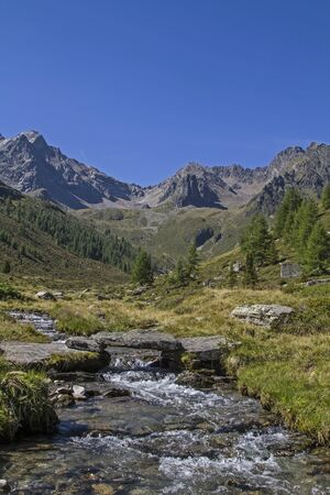 Sommer: Mountain creek in the Oetztal Alps near the Innerbergalm Stock Photo