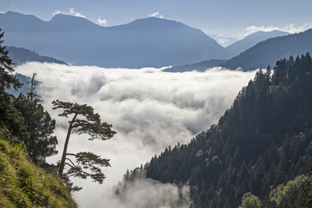 inversion: Inversion situation - autumn mist in front of the hills of the Ester Mountains