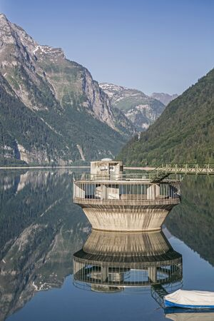 incurred: The Kloental lake is incurred by a landslide  in the canton of Glarus in Switzerland