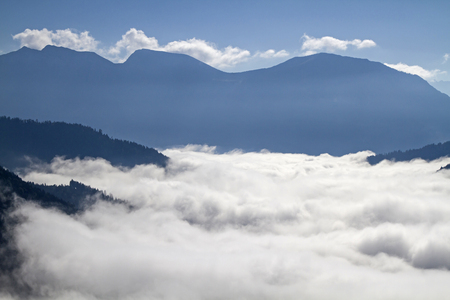 Inversion situation - autumn mist in front of the hills of the Ester Mountains