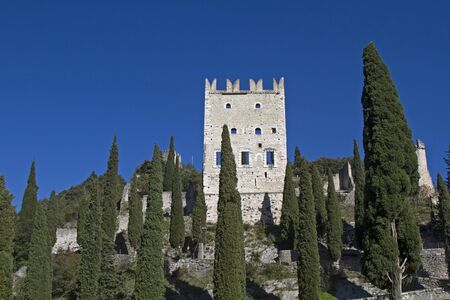mediaeval: On the castle rock in the old town of Arco are the remains of the mediaeval Castle Stock Photo