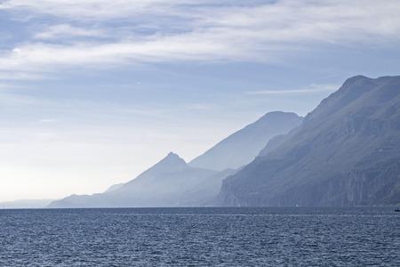 mountain lake: Lake Garda - lake and mountains in backlight Stock Photo