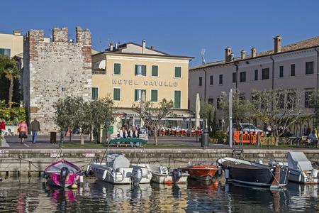 rowboats: Fishing harbor with beach promenade in Bardolino on Lake Garda Editorial