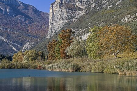 stillness: Autumn on Lake Toblino an idyllic lake in Trentino Stock Photo