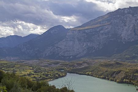 stillness: The idyllic Lake Cavedine was formed by a massive landslide dammed the river Sarca