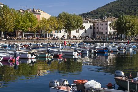 rowboats: Fishing harbor with beach promenade in Garda at Lake Garda