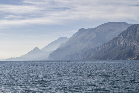 backlight: Lake Garda - lake and mountains in backlight Stock Photo
