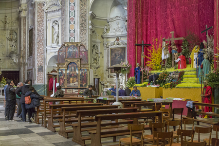 piety: Easter preparations - Building a religious scene in a Ligurian village church