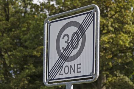 repeal: After leaving the residential area the speed limit is canceled Stock Photo