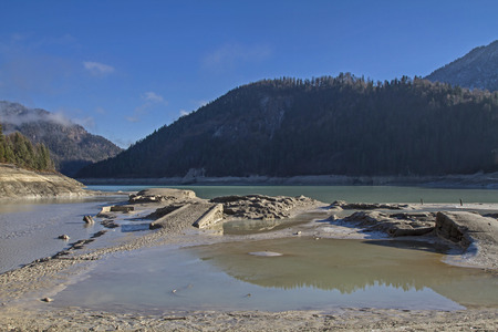 drained: Low tide on Sylvenstein reservoir - In December 2015, the Sylvenstein Reservoir was emptied on a cleat hole due to construction work