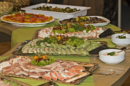 Buffet table loaded with various culinary delights Stock Photo