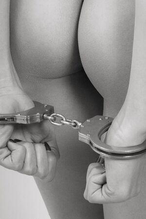 partially nude: Erotic Detailed view of a female body  with handcuffs