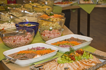 Buffet table loaded with various culinary delights