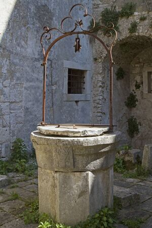 draw well: Old draw well in Kr�an, a small idyllic village situated inland of the Istrian peninsula