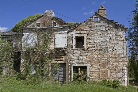 characterize: Abandoned and dilapidated houses idyllic overgrown with plants characterize the idyllic landscape