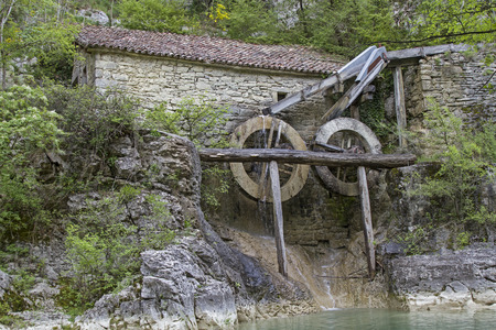 expire: Old mill building with water mills in Kotli, a small hamlet on the upper reaches of Mirna