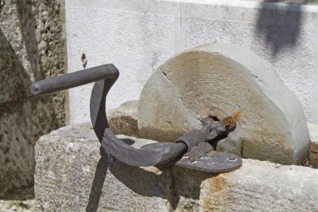 manually: Old whetstone was still manually operated by crank Stock Photo
