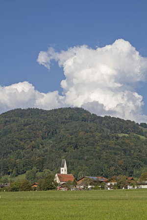 vitus: The parish church St Vitus is situated in the village of Nussdorf and built in the High Gothic style Stock Photo