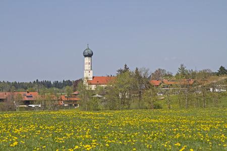 church flower: Waakirchen - Upper Bavarian idyllic village in the Bavarian Alps Stock Photo