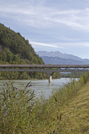 roofed house: The wooden rustic Zollhaus bridge allows pedestrians and cyclists in Niederaudorf crossing to Austria