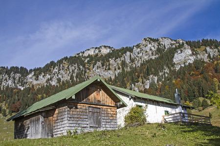 benedict: In south-facing ascent to Benediktenwand you pass the idyllic Middle Krottenalm Stock Photo