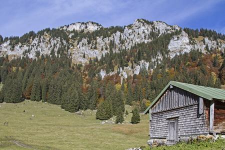 ascent: In south-facing ascent to Benediktenwand you pass the idyllic Middle Krottenalm Stock Photo