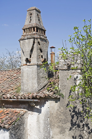 Magnificent decorative house fireplaces on half decayed and deserted houses in the small village Krsan in Istria Stock Photo