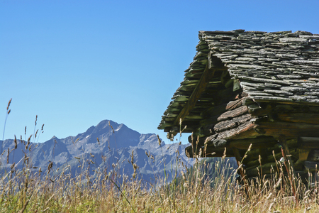 mountain hut: Old abandoned mountain hut in Piedmont against the backdrop of the Valais Mountains