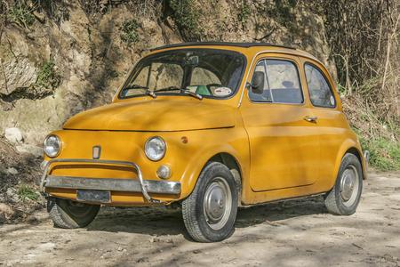 Nostalgia pure - yellow Fiat 500 in an Italian alley