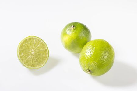 limonene: Limes are green to yellow, roundish with a diameter of three to six centimeters and are very vitamin-rich. Stock Photo