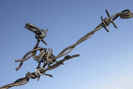 Two barbed wires connected to a provisional node Stock Photo