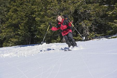 Downhill ski touring of a female ski tourist  in Upper Bavaria