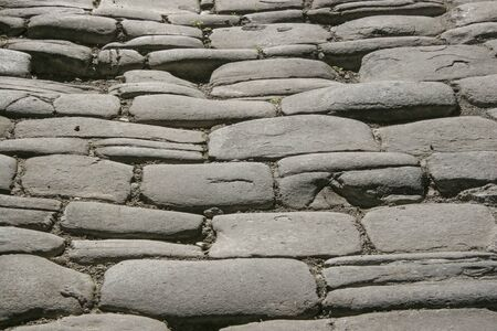 Background image - Detail of an italian alley with cobblestone pavement Standard-Bild