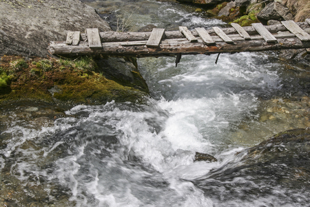 Mountain stream with footbridge at Sand in Taufers in the Ahrntal valley in South Tyrol